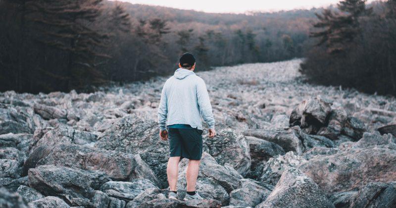 Man walking on rocks in Pittsburgh