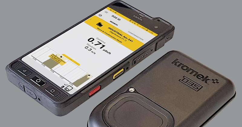 D3S ID radiation detector next to rugged phone app